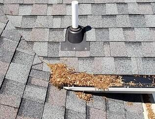 debris roof leak from debris in gutter that goes into a roof valley