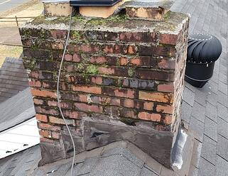 roof leak from water in mortar joints on a chimney