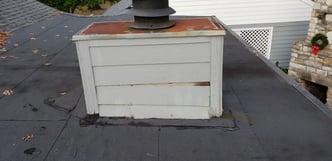 roof leak from chimney siding damage