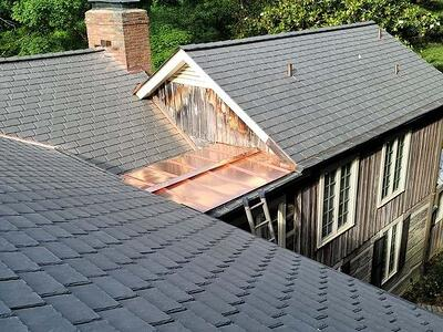 How Much Does a Synthetic Slate Roof Cost? (& What Impacts the Price)