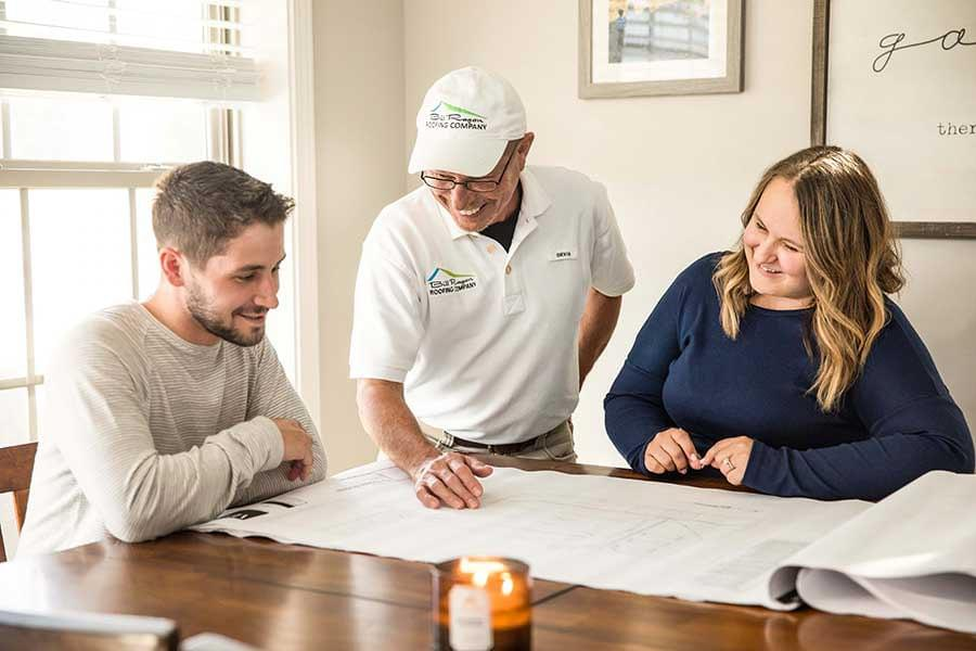Bill-Ragan-Roofing-Client-Meeting-table